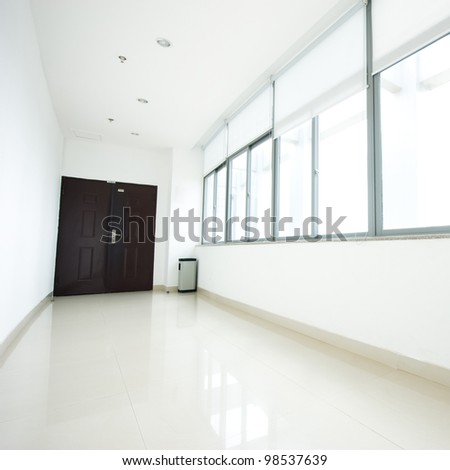 empty long corridor in the modern office building.