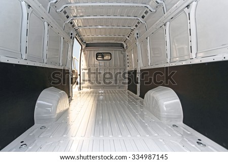 Empty Long White Delivery Van Transport - stock photo