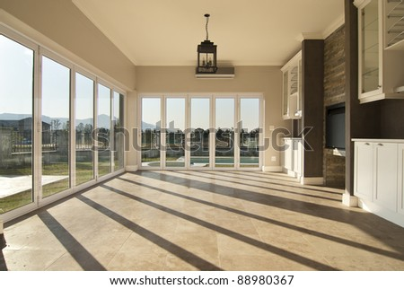 Empty lounge of a modern house - stock photo