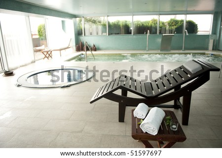Empty luxury spa with jacuzzi and swimming pool - stock photo