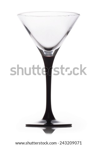 Empty martini glass isolated on a white background - stock photo