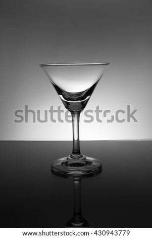 Empty Martini glass. on a black background