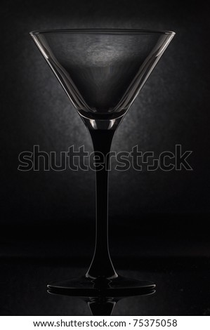 empty martini glass on a black background