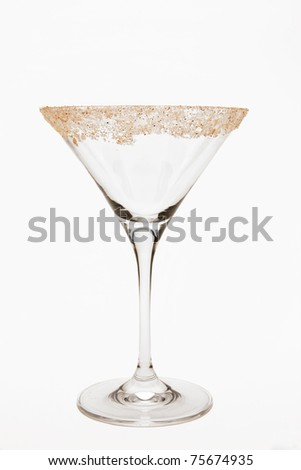 Empty martini glass with rim of glass garnished with salt, sugar and pepper mixture. - stock photo