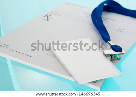 Empty medical identification tag with stethoscope on medical prescription and blue background - stock photo