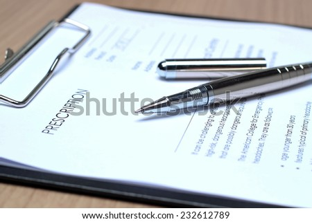 Empty medical prescription with a pen  - stock photo