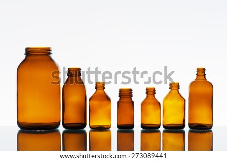 Empty medicine bottles on the light background - stock photo