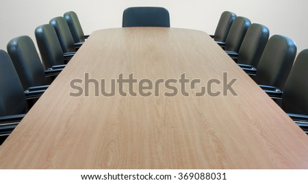 Empty meeting room and conference table - stock photo