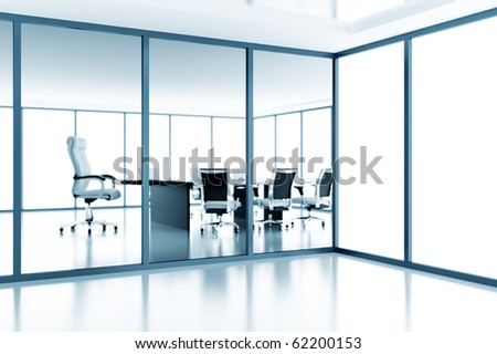 Empty meeting room behind a glass partition in modern cubicle - stock photo