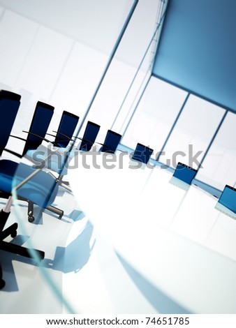 Empty meeting room with rounded table and light from windows - stock photo