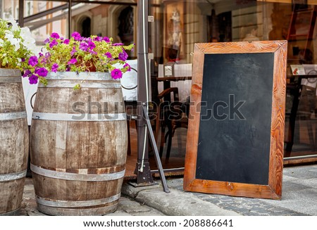 Empty menu board on street - stock photo