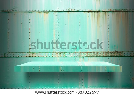empty metal shelves top Ready for product display montage; metal shelves and green metal background. - stock photo