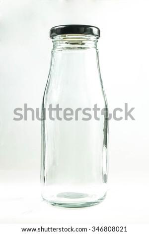empty milk bottle on white background - stock photo