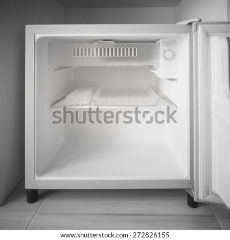 Empty mini fridge. - stock photo