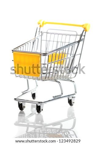 Empty miniature shopping trolley on white background - stock photo