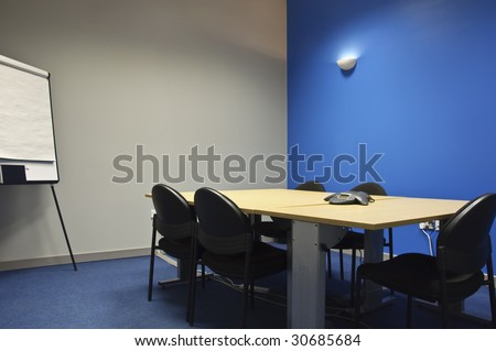 empty modern classroom or meeting room with flip white boards - stock photo