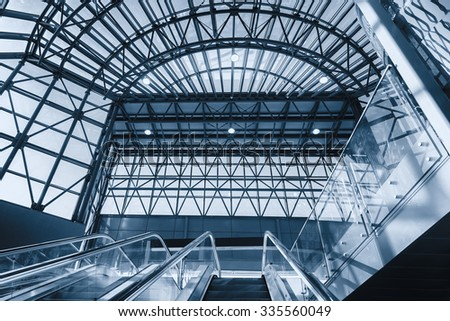 Empty modern escalators in the station - stock photo
