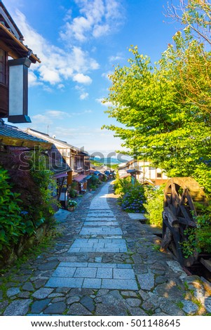 Empty morning on the Magome-Tsumago portion of the historic Nakasendo road looking south in the town of Magome in Japan. Vertical