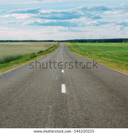 Empty motorway, highway, and green field in rural area