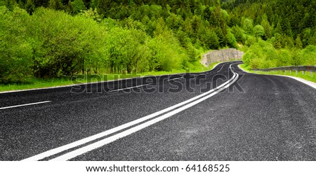 Empty mountain road - stock photo