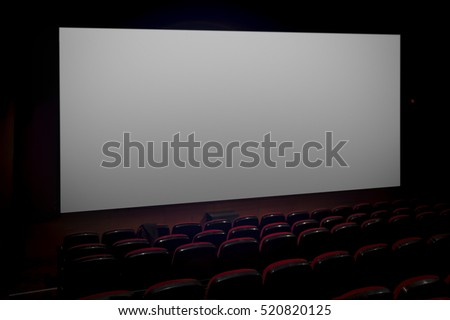 Empty movie theater with blank screen