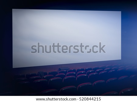 Empty movie theater with projection on blank screen