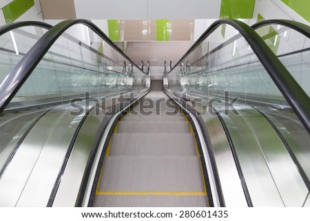 Empty moving escalator stairs from above in Sofia's subway. - stock photo