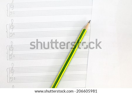 Empty music sheet with pencil - stock photo