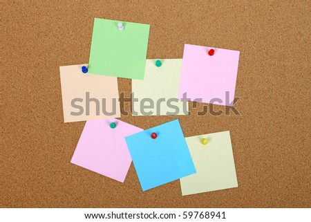 Empty note paper attached to cork board. Space for adding text. - stock photo