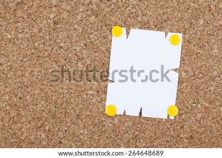 Empty Note Paper Pinned on Bulletin Board - stock photo