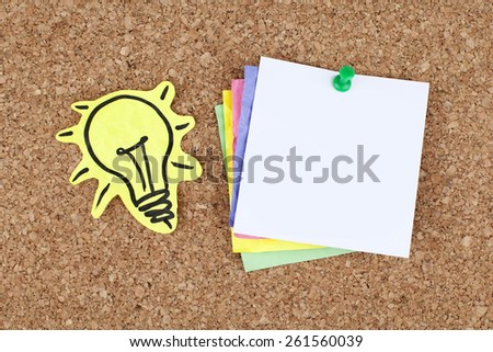 Empty Note Paper Pinned on Cork Bulletin Board and Light Bulb - stock photo