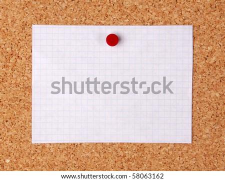 Empty note pinned on corkboard - stock photo
