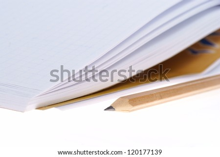 empty notebook and pencil isolated on white background