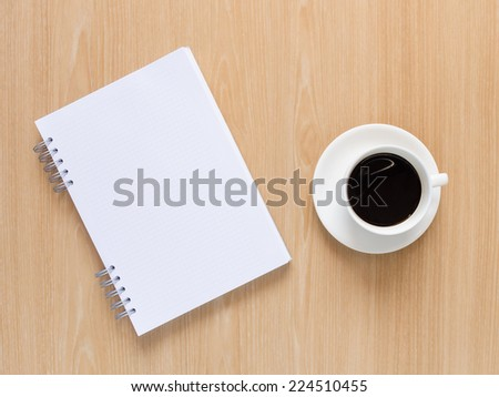 Empty notebook with coffee cup on wooden background. - stock photo