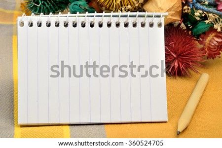 Empty notebook with dried flowers decoration on table