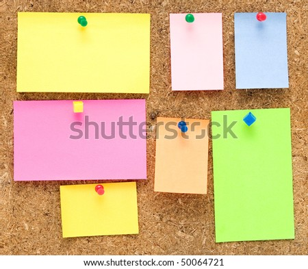 empty notes on old wooden background