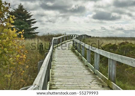 Empty Ocean Boardwalk Crossing Sand Dunes - stock photo