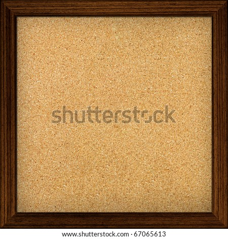 Empty office cork notice board isolated with wood frame - stock photo