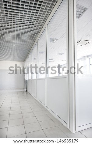 Empty office room with glass walls  - stock photo