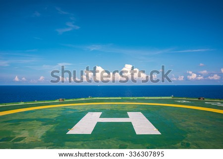 Empty oil rig helipad with few cloud and blue sky in Gulf of Thailand - stock photo