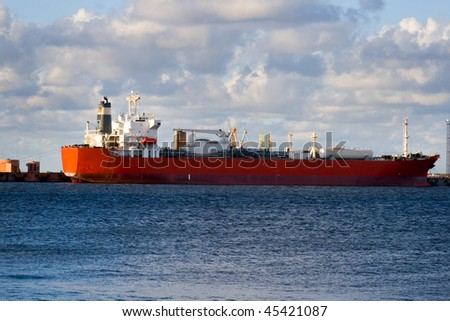 Empty oil tanker is loading in port of Ventspils, Latvia. - stock photo