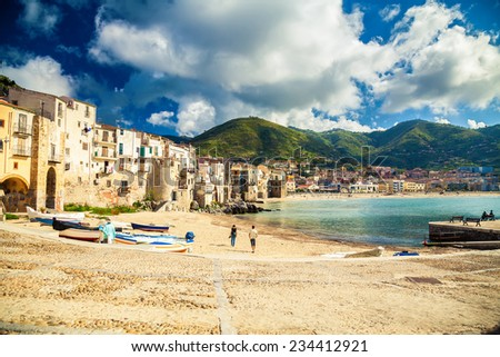 empty old beach of Cefalu with fishing boats, Sicily, Italy - stock photo