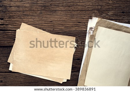 Empty old paper on wooden table - vintage background - stock photo