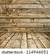 Empty old spacious room with wooden grungy wall and weathered dirty floor, vintage background texture - stock photo