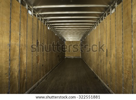 Empty old truck trailer with plywood sides