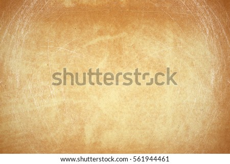 empty old vintage paper background in frame. Weathered and ancient Kraft Paper texture