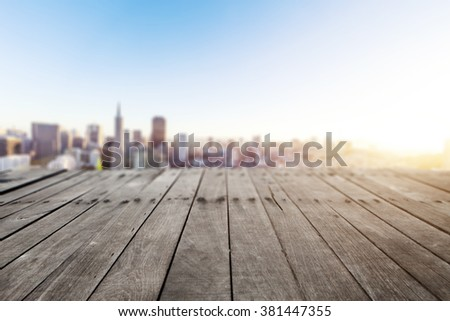 empty old wood floor with cityscape of San Francisco in sunny day