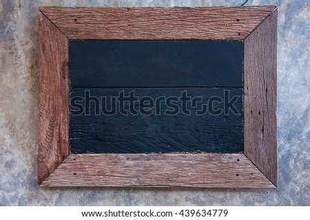 empty old wood frame on cement background - stock photo