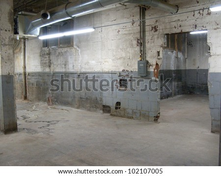 Empty older warehouse / industrial space with grey  white walls - stock photo