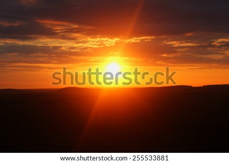 Empty, only rays dawn closeup sun. Freedom. Bright big sun rise on sky with yellow orange red gradient colors. Summer, day. amazing, inspirational sunbeam. shore horizon. smooth backdrop, wallpaper  - stock photo